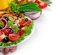 Greek cuisine - fresh vegetable salad isolated on white background - stock photo