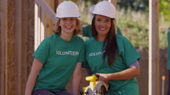 Portrait of volunteers working on construction project - stock footage