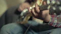 man playing bass guitar pan through strings slow motion - stock footage