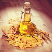 Pasta and oil in a glass. Vintage retro hipster style version Stock Photos