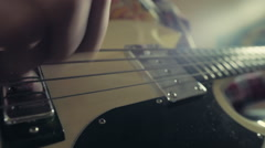 Man playing bass guitar closeup Stock Footage