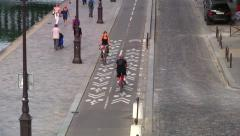Cycling through the Seine River, Paris, zoom out Stock Footage