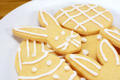 Close up of frosted Easter cookies on a plate Stock Photos
