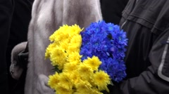 Flowers with Ukrainian symbolism in the hands of an unknown at t Stock Footage