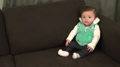 Infant in Couch Corner Stock Footage