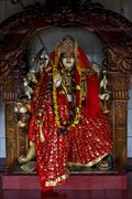 precious stone   wood statue of a Hinduism  women - stock photo