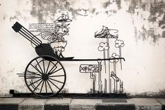 Penang artistic sign, with rendering of a rickshaw, points out an important  Stock Photos