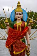 wood statue of a Hinduism  women - stock photo
