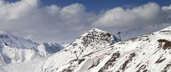 Off-piste slope and chair-lift in little snow year. Panoramic view. - stock photo