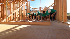 Volunteers working together lifting wall Stock Footage