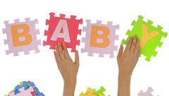"""Hands forming word """"Baby"""" with jigsaw puzzle pieces isolated - stock illustration"""