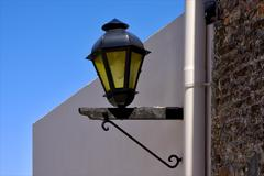 Street lamp and a water pipe in colonia del sacramento Stock Photos