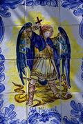 ceramics design of san miguel and the dragon - stock photo