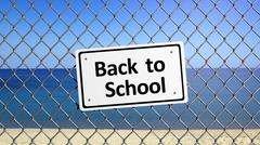 Beach enclosed by fence with sign Back to School - stock illustration