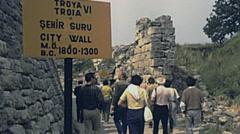 Turkey 1980s: visitors walking in Troya Stock Footage