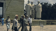 Turkey 1980s: tourist walking in front of three white statue Stock Footage