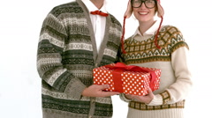 In slow motion geeky hipster couple holding present Stock Footage