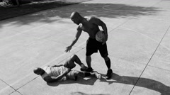 One on one street basketball Stock Footage