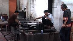 Vietnam Men making pottery Stock Footage