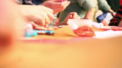 Close-up of hands painting with gingerbread cookie and pipping bag. HD Stock Footage