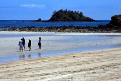 people in andilana beach nosy be - stock photo