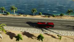 Bus driving along the coastal road Stock Footage