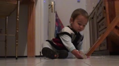 Baby eats crackers from the floor - stock footage