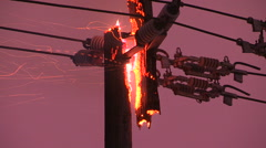 Hydro power pole and electrical wires on fire in Toronto ice storm Stock Footage