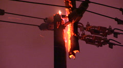 Hydro power pole and electrical wires on fire in Toronto ice storm - stock footage