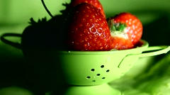 Strawberries in a small colander Stock Footage