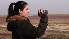 Young Woman With Video Camera Outdoor Stock Footage