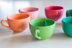 Multicolor cup's on a table Stock Photos