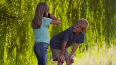 Two kids looking through binoculars - stock footage