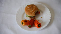 Juicy meat burger being eated as it dissapears on a plate Stock Footage