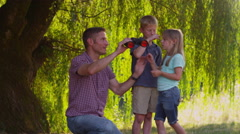 Father and children looking through binoculars - stock footage
