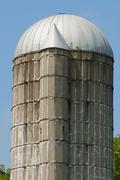 Grain silo on the farmland. Stock Photos