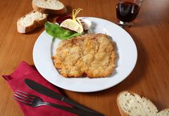 Breaded cutlet and vegetables Stock Photos