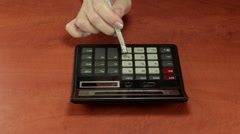 Pushing calculator buttons with pencil eraser Stock Footage