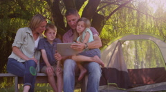 Family using digital tablet outdoors - stock footage