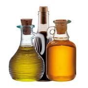 Three bottles of olive, oil and vinegar Stock Photos
