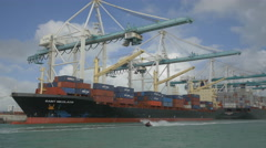 Miami port with Jet skis near a container ship Stock Footage