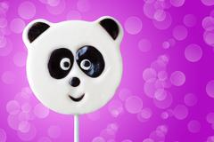 lollipop in the form of an panda - stock photo