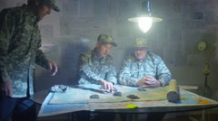 4K Military officers in army bunker, looking at map & discussing battle strategy Arkistovideo