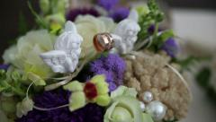 Wedding rings and floral decorations Stock Footage