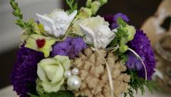 Floral decorations and wedding rings Stock Footage