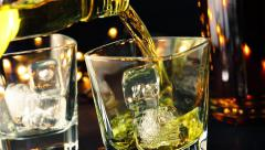 Barman pouring whiskey on bar table near bottles, whisky relax time concept Stock Footage