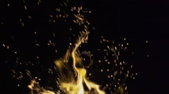 Detail shot of sparks coming out of fire at night Stock Footage