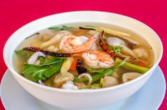 Hot and sour seafood soup (Tom Yam) - stock photo