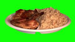 Fried chicken wings, rice with vegetables on throwaway plate - stock footage