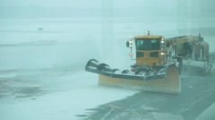 Snowplow cleaning airstrip - stock footage